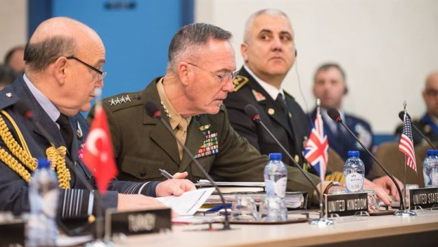 Gen. Joe Dunford, chairman of the Joint Chiefs of Staff, meets with his counterparts at a NATO meeting in Brussels, Jan. 17, 2017. DoD photo by Army Sgt. James K. McCann