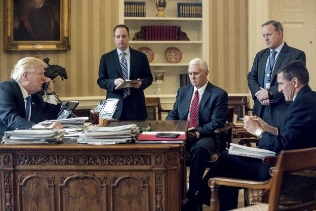 Michael Flynn seen on extreme right in a meeting with Trump and his team Pic AP 28 Jan 2017
