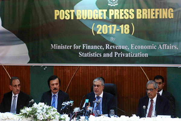 Pakistan Finance Minister Senator Mohammad Ishaq Dar briefs media during post budget press conference Pic APP