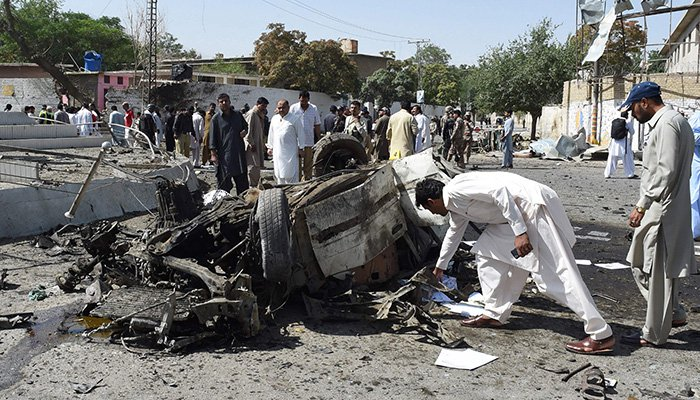 Pakistani security officials inspect the site of a powerful explosion that targeted a police vehicle in Quetta – Photo AFP