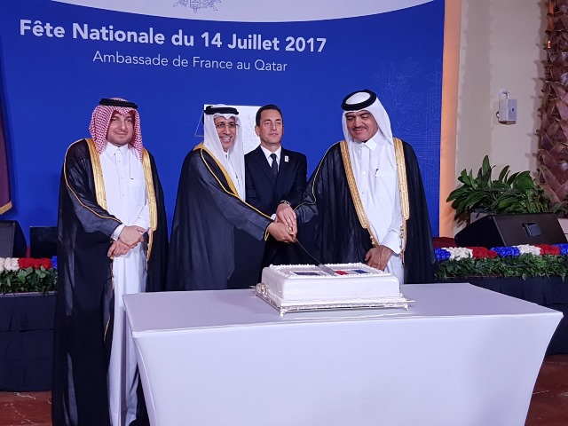 Minister of Justice and Minister of Environment of Qatar cutting French National Day Cake along with amb Eric Chevellier and amb Ibrahim Fakhroo, Chief of Protocol of Qatar