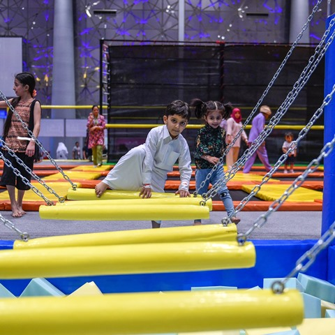 The child trying out the obstacle course at Summer Entertainment City. The two month event features the world's largest obstacle course, along with Qatar's largest trampoline park