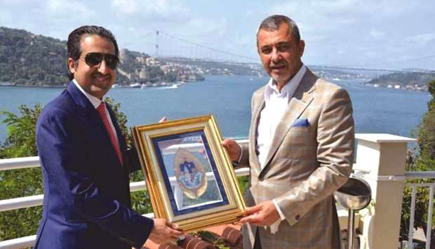 Al-Sharqi receives a token of recognition from Shakler during the Qatari business delegation's visit to Turkey recently.
