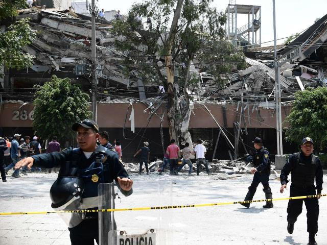 An injured woman is pictured in Mexico City after a 7dot1 magnitude earthquake Pic AFP