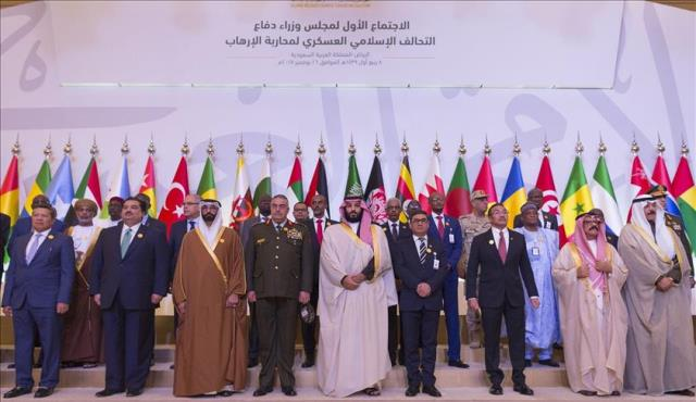 Prince Mohammed bin Salman Al Saud (C) poses for a family photo during Islamic Military Counter Terrorism Coalition (IMCTC) Defense Ministers' Meeting at Al Faisaliah Hotel in Riyadh Pic