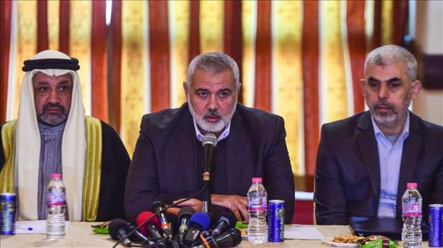 Ismail Haniyeh (C), Head of Political Bureau of Hamas seen with Yahya Sinwar (R) in Gaza City, Gaza on Dec 26, 2017. Pic by Anadolu Agency