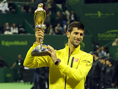 Novak Djokovic of Serbia celebrates victory after defeating Rafael Nadal of Spain during the Qatar ExxonMobil