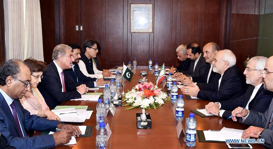 Pakistani Foreign Minister Shah Mahmood Qureshi and Iran FM Mohammad Javad Zarif (3rd R) in Islamabad,