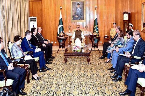 Turkish Foreign Minister Mevlut Cavusoglu called on President Dr. Arif Alvi at the Aiwan-e-Sadr Pic APP