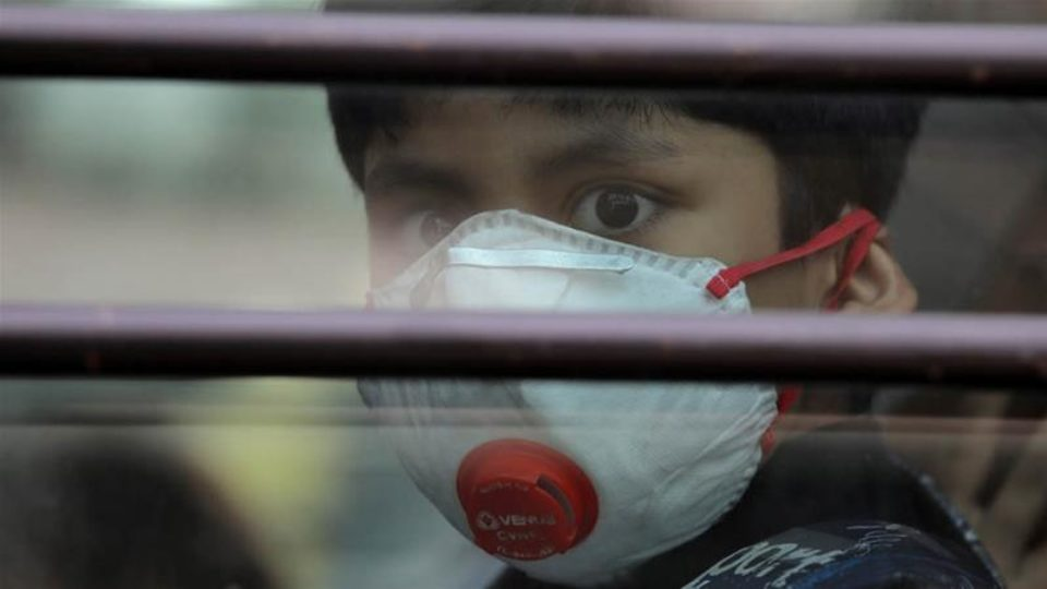 A schoolboy wearing a protective mask in Ghaziabad on the outskirts of Delhi Pic Reuters