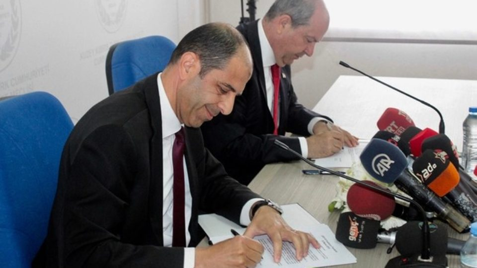 UBP leader and PM-designate Ersin Tatar on right and HP leader Kudret Özersay sign the coalition protocol at the TRNC Parliament in Nicosia, on 22 May 2019