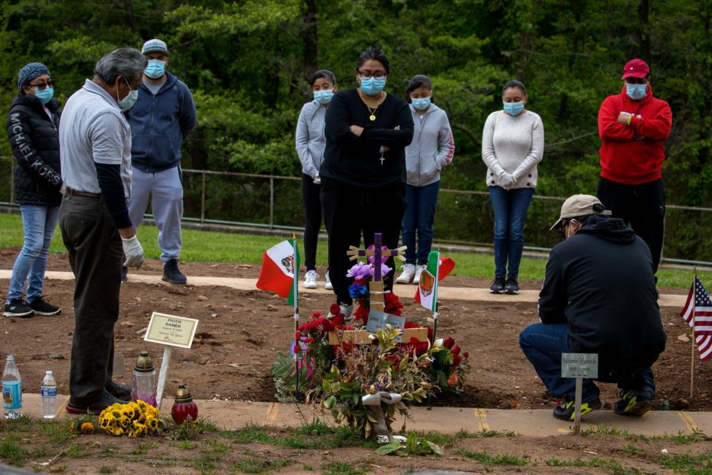 Angelli Gonzalez and her family visited grave of Maria Gonzalez, at St. Peter's Cemetery, Staten Island, Pic New York Times