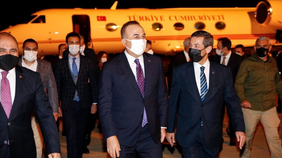 Turkish Foreign Minister Mevlut Cavusoglu welcomed by TRNC Foreign Minister Tahsin Ertugruloglu at Ercan Airport, Nicosia, April 15, 2021.Anadolu News