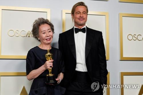 Youn Yuh-jung poses with Brad Pitt after receiving Best Actress in a Supporting Role AFP