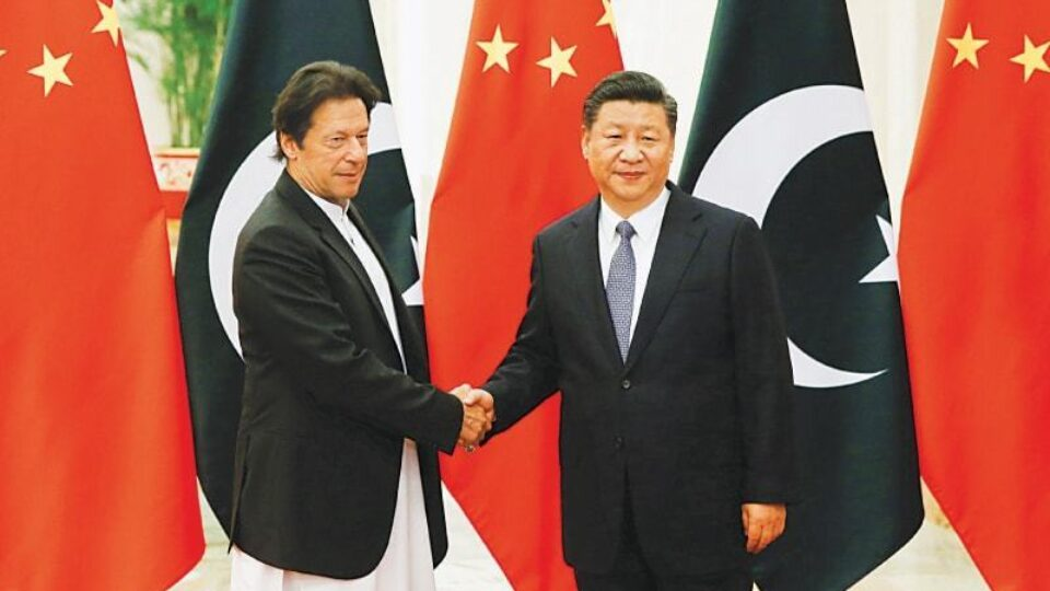 Imran Khan on left with Chinese President Xi Jinping File Pic by DAWN